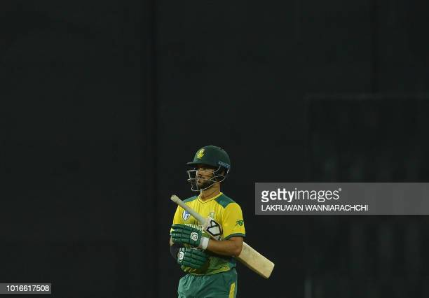 South Africa's JP Duminy walks back to the pavilion after his dismissal during the international Twenty20 cricket match between Sri Lanka and South...