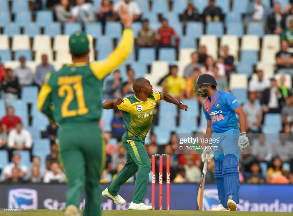 South Africa's Junior Dala (C) celebrates after a leg before wicket (LBW) decision to dismiss India's Rohit Sharma (R) during the second T20I cricket match between South Africa and India at Super Sport Park Stadium in Pretoria on February 21, 2018. / AFP PHOTO / Christiaan Kotze