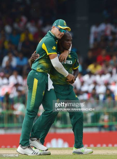 South Africa's Junior Dala celebrates with his teammate Aiden Markram after he dismissed Sri Lanka's Upul Tharanga during the fifth and final One Day...