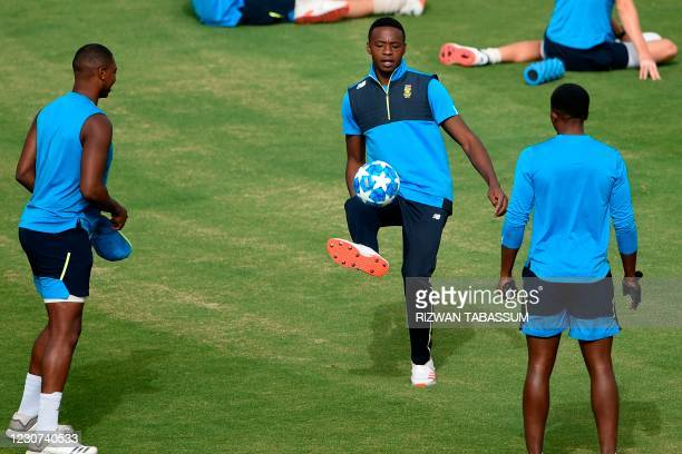 South Africa's Kagiso Rabada along with teammates attend a practice session at the National Stadium in Karachi on January 23 ahead of their first...
