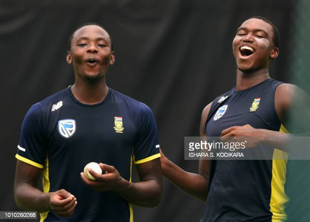 South Africa's Kagiso Rabada and Lungi Ngidi takes part in a training session at Pallekele International Cricket Stadium in Pallekele on August 3...