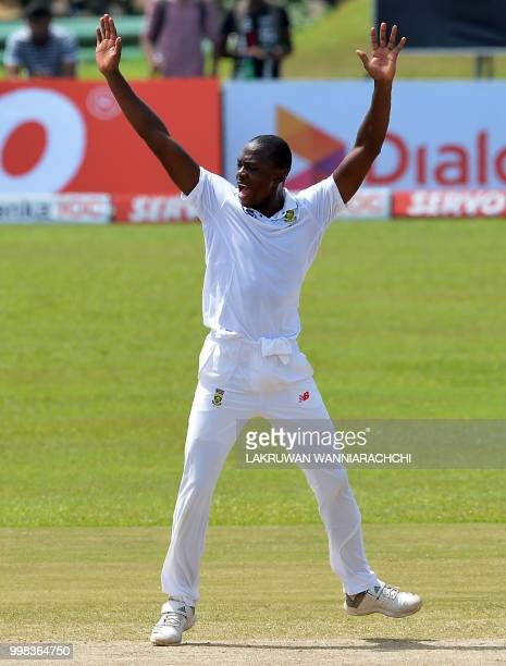South Africa's Kagiso Rabada celebrates after he dismissed Sri Lanka's Dilruwan Perera during the third day of the opening Test match between Sri...
