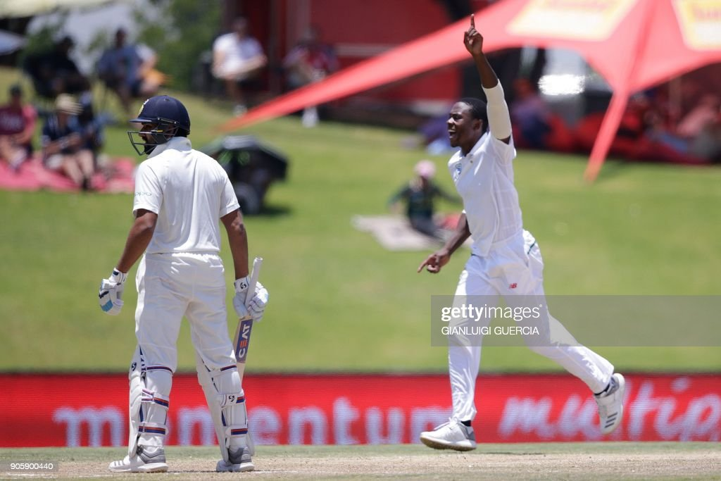 South Africa's Kagiso Rabada celebrates the dismissal of India's Rohit Sharma (L) during the fifth day of the second Test cricket match between South Africa and India at Supersport cricket ground on January 17, 2018 in Centurion, South Africa. /