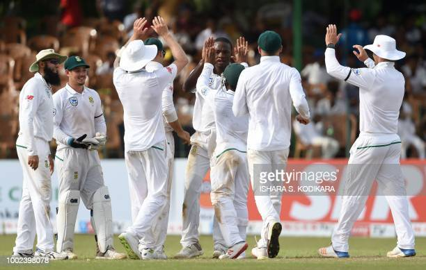 South Africa's Kagiso Rabada celebrates with his teammates after he dismissed Sri Lankan cricketer Roshen Silva during the first day of the second...