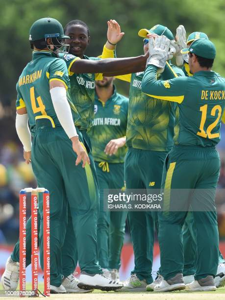 South Africa's Kagiso Rabada celebrates with his teammates after he dismissed Sri Lankan cricketer Kusal Mendis during the first One Day...