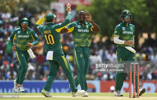 South Africa's Kagiso Rabada celebrates with his teammates after he dismissed Sri Lankan cricketer Shehan Jayasuriya during the first One Day...
