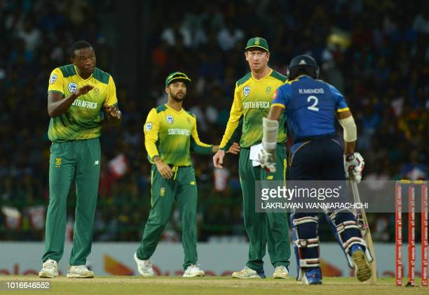 South Africa's Kagiso Rabada celebrates with his teammates after he dismissed Sri Lanka's Kusal Mendis during the international Twenty20 cricket...