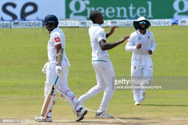 South Africa's Kagiso Rabada celebrates with his teammates after he dismissed Sri Lanka's Dilruwan Perera during the third day of the opening Test...