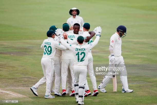 South Africa's Kagiso Rabada celebrates with teammates after the dismissal of England's Sam Curran during the fourth day of the first Test cricket...