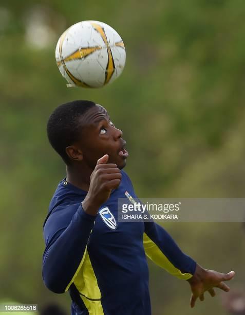 South Africa's Kagiso Rabada play football during a training session at the Rangiri Dambulla International Cricket Stadium in Dambulla on July 31...
