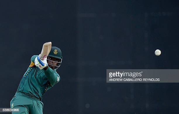 South Africa's Kagiso Rabada plays a shot during a Oneday International cricket match between South Africa and Australia in the TriNation Series in...