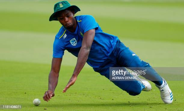 South Africa's Kagiso Rabada stops a ball during fielding practice at Lords Cricket Ground in London on June 22 ahead of South Africa's next 2019...