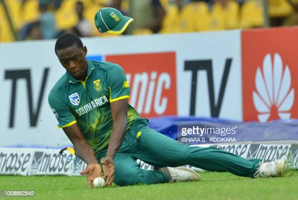 South Africa's Kagiso Rabada stops the ball during the second oneday international match between Sri Lanka and South Africa at the Rangiri Dambulla...
