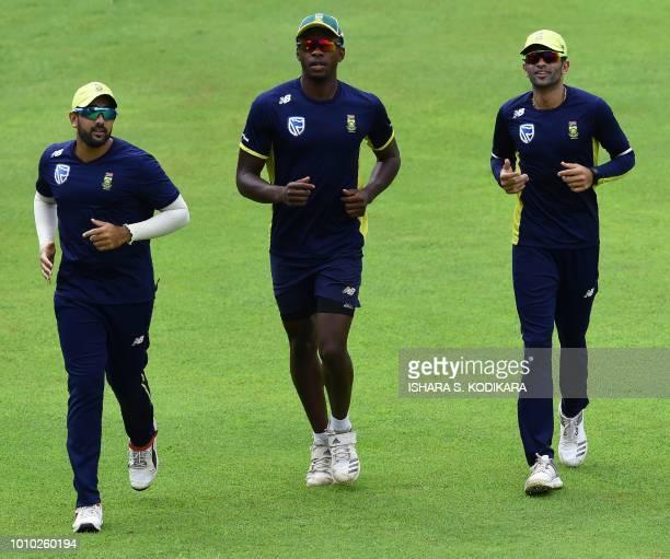 South Africa's Kagiso Rabada Tabraiz Shamsi and Keshav Maharaj run during a training session at Pallekele International Cricket Stadium in Pallekele...
