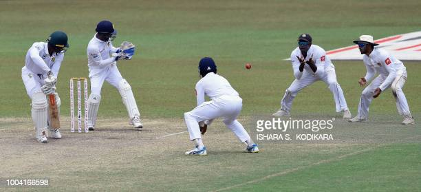 South Africa's Kagiso Rabada watches as Sri Lanka's Angelo Mathews takes a catch to dismiss him as wicketkeeper Niroshan Dickwella reacts during the...