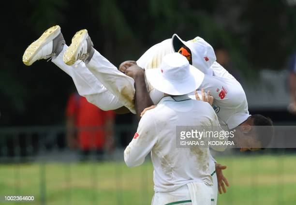 South Africa's Keshav Maharaj and Kagiso Rabada celebrates after he dismissed Sri Lanka's Danushka Gunathilaka during the first day of the second...