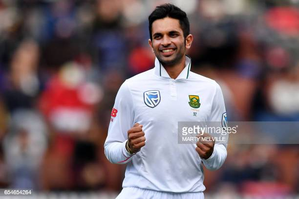 South Africa's Keshav Maharaj celebrates New Zealand's BJ Watling being caught during day three of the second Test cricket match between New Zealand...