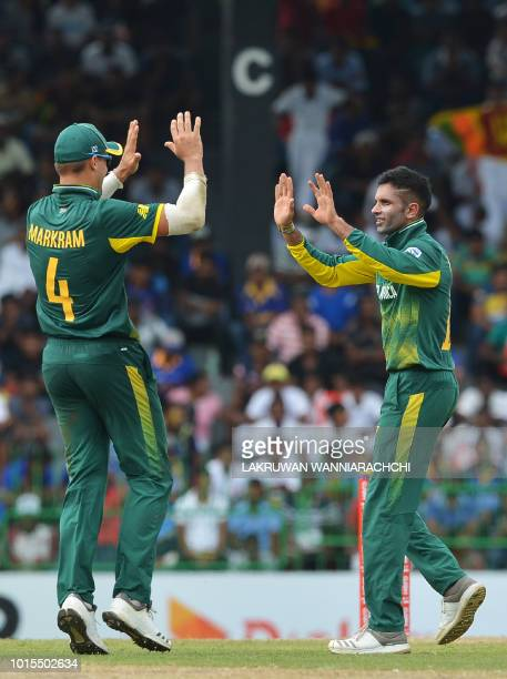 South Africa's Keshav Maharaj celebrates with his teammate Aiden Markram after he dismissed Sri Lanka's Kusal Mendis during the fifth and final one...