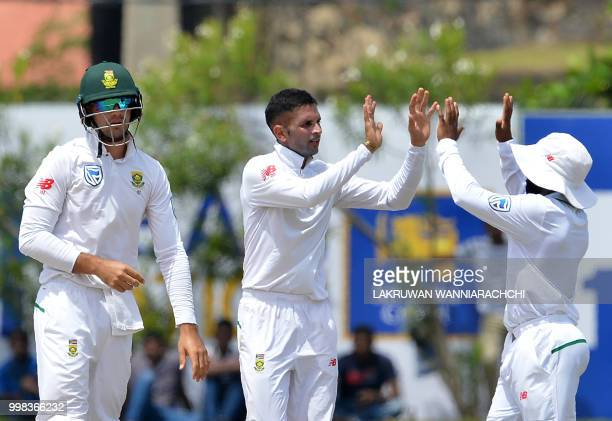 South Africa's Keshav Maharaj celebrates with his teammates after he dismissed Sri Lanka's Angelo Mathews during the third day of the opening Test...