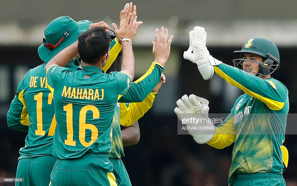 South Africa's Keshav Maharaj (2L) celebrates with South Africa's Quinton de Kock (R) after they took the wicket of England's Jonny Bairstow (unseen) for 51 runs during the third One-Day International (ODI) cricket match between England and South Africa at Lord's Cricket Ground in London on May 29, 2017. / AFP PHOTO / Adrian DENNIS