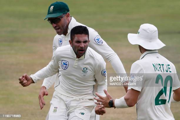 South Africa's Keshav Maharaj celebrates with teammates after the dismissal of England's Ben Stokes during the fourth day of the first Test cricket...