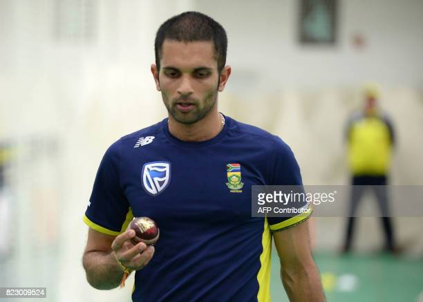 South Africa's Keshav Maharaj holds a cricket ball during the south African cricket team's training session at The Oval cricket ground in south...