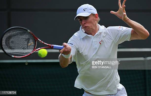 South Africa's Kevin Andersen plays against Serbian player Novak Djokovic in a Men's Singles match at the 2011 Wimbledon Tennis Championships at the...