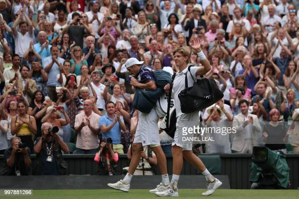 South Africa's Kevin Anderson and US player John Isner leave following the final set tiebreak of their men's singles semifinal match on the eleventh...