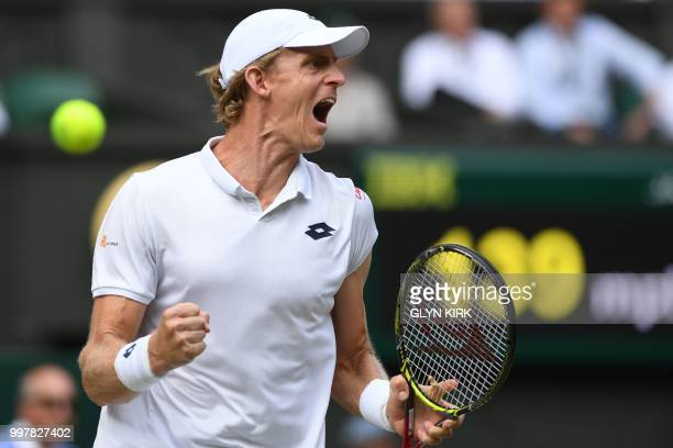 South Africa's Kevin Anderson celebrates a point against US player John Isner during their men's singles semifinal match on the eleventh day of the...