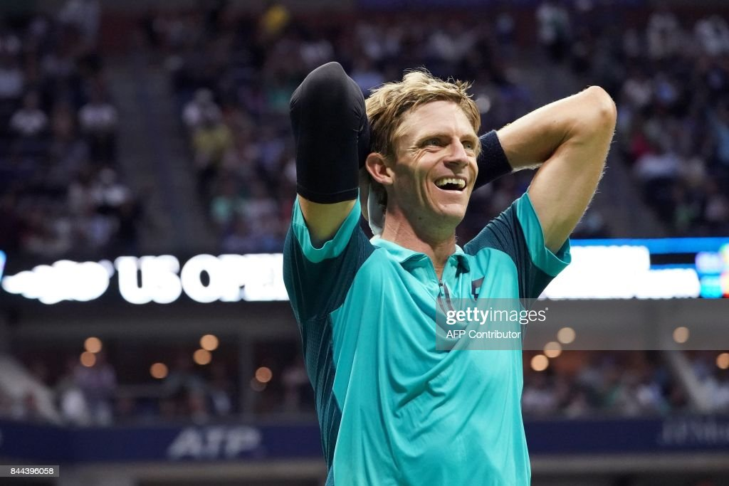 TOPSHOT - South Africa's Kevin Anderson celebrates after defeating Spain's Pablo Carreno Busta during their 2017 US Open Men's Single Semifinals match at the USTA Billie Jean King National Tennis Center in New York on September 8, 2017. South Africa's Kevin Anderson advanced to his first Grand Slam final on Friday by defeating Spanish 12th seed Pablo Carreno Busta 4-6, 7-5, 6-3, 6-4. / AFP PHOTO / Don EMMERT
