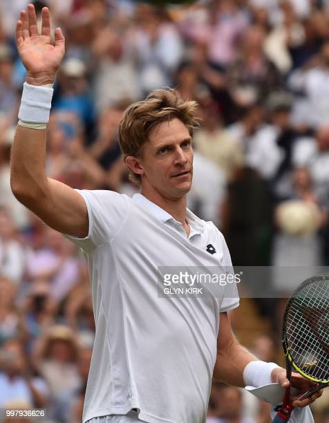 South Africa's Kevin Anderson celebrates after winning against US player John Isner during the final set tiebreak of their men's singles semifinal...