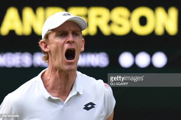 South Africa's Kevin Anderson celebrates winning a point against US player John Isner during their men's singles semifinal match on the eleventh day...