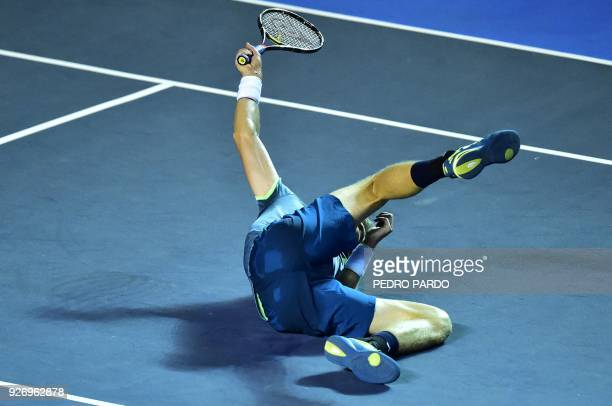 TOPSHOT South Africas Kevin Anderson falls on the court during his Mexico ATP 500 Open men's single final tennis match against Argentina's Juan...