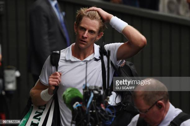 TOPSHOT South Africa's Kevin Anderson leaves the court after winning against US player John Isner during their men's singles semifinal match on the...