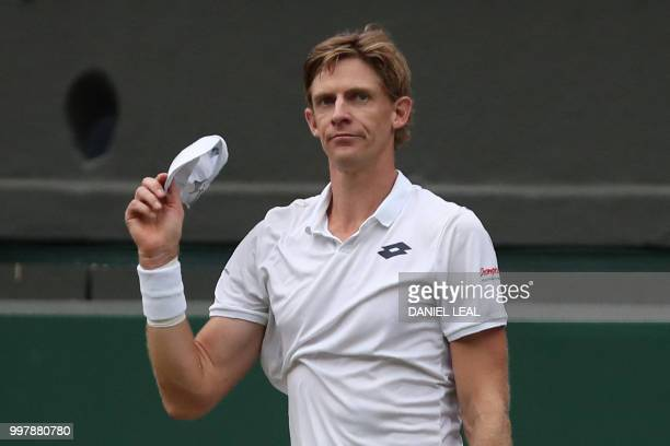 South Africa's Kevin Anderson reacts after winning against US player John Isner during the final set tiebreak of their men's singles semifinal match...