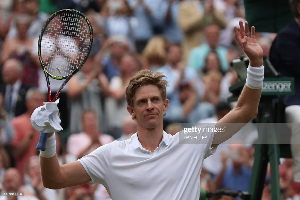 TOPSHOT - South Africa's Kevin Anderson reacts after winning against US player John Isner during the final set tie-break of their men's singles semi-final match on the eleventh day of the 2018 Wimbledon Championships at The All England Lawn Tennis Club in Wimbledon, southwest London, on July 13, 2018. - Anderson won the match 7-6, 6-7, 6-7, 6-4, 26-24. (Photo by Daniel LEAL-OLIVAS / AFP) / RESTRICTED