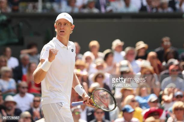South Africa's Kevin Anderson reacts after winning the first set against US player John Isner during their men's singles semi-final match on the...