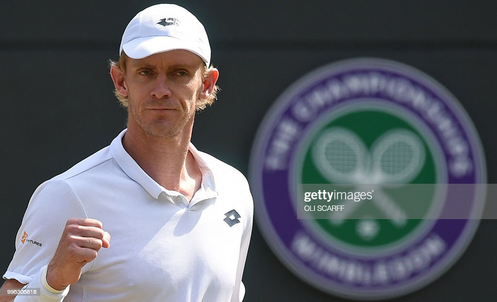 South Africa's Kevin Anderson reacts after winning the fourth set against Switzerland's Roger Federer during their men's singles quarter-finals match on the ninth day of the 2018 Wimbledon Championships at The All England Lawn Tennis Club in Wimbledon, southwest London, on July 11, 2018. (Photo by Oli SCARFF / AFP) / RESTRICTED