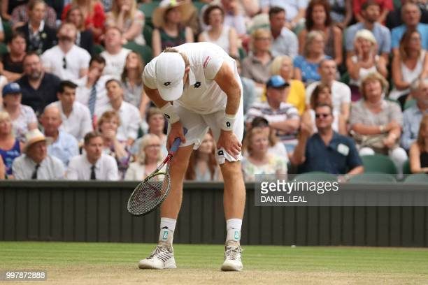 TOPSHOT South Africa's Kevin Anderson reacts against US player John Isner during the final set tiebreak of their men's singles semifinal match on the...