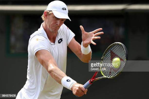 South Africa's Kevin Anderson returns against France's Gael Monfils during their men's singles fourth round match on the seventh day of the 2018...