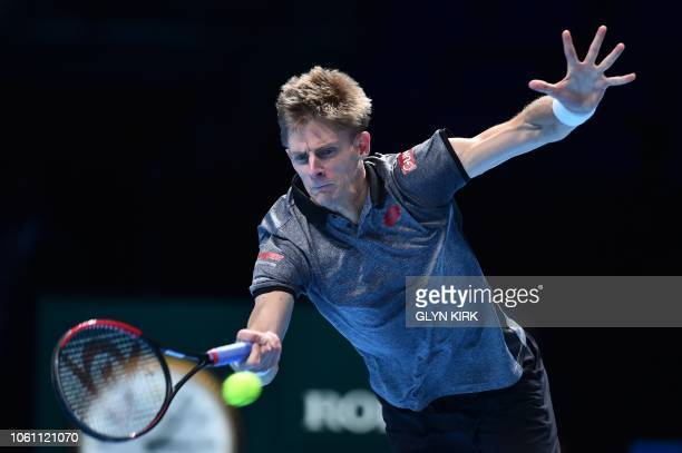 South Africa's Kevin Anderson returns against Japan's Kei Nishikori during their men's singles roundrobin match on day three of the ATP World Tour...