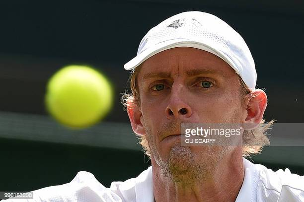 South Africa's Kevin Anderson returns against Switzerland's Roger Federer during their men's singles quarter-finals match on the ninth day of the...