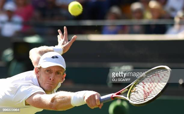 TOPSHOT South Africa's Kevin Anderson returns against Switzerland's Roger Federer during their men's singles quarterfinals match on the ninth day of...