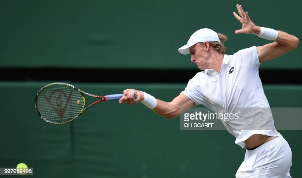 South Africa's Kevin Anderson returns against US player John Isner during their men's singles semi-final match on the eleventh day of the 2018...
