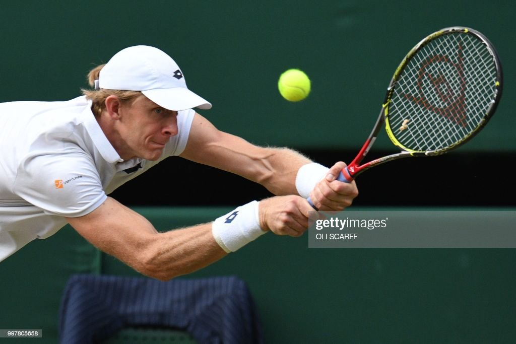 TOPSHOT - South Africa's Kevin Anderson returns against US player John Isner during their men's singles semi-final match on the eleventh day of the 2018 Wimbledon Championships at The All England Lawn Tennis Club in Wimbledon, southwest London, on July 13, 2018. (Photo by Oli SCARFF / AFP) / RESTRICTED