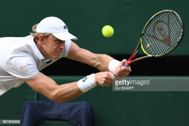 TOPSHOT South Africa's Kevin Anderson returns against US player John Isner during their men's singles semifinal match on the eleventh day of the 2018...