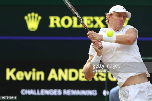 South Africa's Kevin Anderson returns against US player John Isner during the final set tiebreak of their men's singles semifinal match on the...