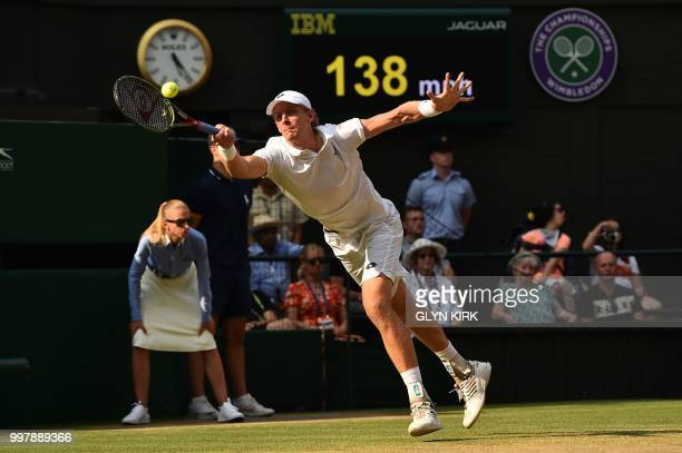 TOPSHOT South Africa's Kevin Anderson returns against US player John Isner during the final set tiebreak of their men's singles semifinal match on...