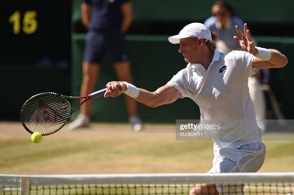 TOPSHOT - South Africa's Kevin Anderson returns to Serbia's Novak Djokovic in their men's singles final match on the thirteenth day of the 2018 Wimbledon Championships at The All England Lawn Tennis Club in Wimbledon, southwest London, on July 15, 2018. (Photo by Oli SCARFF / AFP) / RESTRICTED