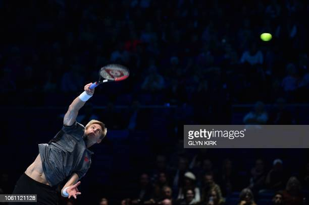 South Africa's Kevin Anderson serves against Japan's Kei Nishikori during their men's singles roundrobin match on day three of the ATP World Tour...